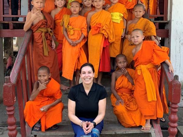 Carol Kijac, author of The Wayward Explorer, teaching English to monks in Laos.